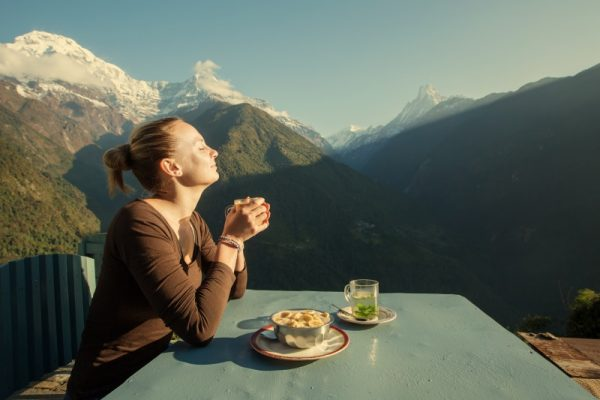 Travel enjoying coffee with view of Himalay mountains