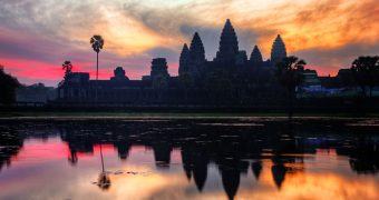 Vietnam Cambodia 12 days highlights tour--Sunrise at Angkor Wat Temples in Cambodia.